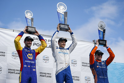 Scoring his third victory of the 2021 season, Alex Palou (center) led a Honda sweep of the NTT IndyCar Series race Sunday at Portland International Raceway, with Alexander Rossi (left) finishing second and Scott Dixon (right), third.